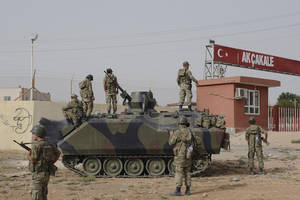 Photo -   Turkish military station at the border gate with Syria, across from Syrian rebel-controlled Tel Abyad town, in Akcakale, Turkey, Sunday, Oct. 7, 2012. (AP Photo)