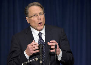 "Photo - The National Rifle Association executive vice president Wayne LaPierre, gestures during a news conference in response to the Connecticut school shooting on Friday, Dec. 21, 2012 in Washington.  The nation's largest gun-rights lobby is calling for armed police officers to be posted in every American school to stop the next killer ""waiting in the wings.""  (AP Photo/ Evan Vucci)"