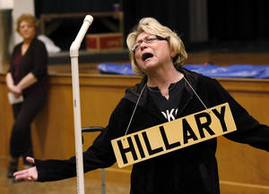 Billie Rodely plays the part of Secretary of State Hillary Clinton in the show. In preparation for the annual OKC Gridiron Show next week,  cast members went through a  dress rehearsal of sorts Saturday afternoon, Feb. 23, 2013, in the Harding Fine Arts Academy.  The guy who plays Obama looks a lot like Obama, and there's also a Mitt Romney, Gov. Fallin, a FOI guy (poking fun at her records scandal), John Doak, blind NFL referees, Janet Baressi and an education mob, Olympic swimmers, Hillary Clinton and the nicest piano player you'll ever meet.  Photo by Jim Beckel, The Oklahoman