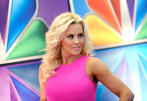 "Photo -   FILE - This May 14, 2012 file photo shows ""Love In The Wild"" host Jenny McCarthy arrives for the NBC network upfront presentation at Radio City Music Hall in New York. McCarthy, who is from suburban Chicago, released a statement Friday, Aug. 17, 2012, saying that she is no longer romantically involved with Chicago Bears linebacker Brian Urlacher. (AP Photo/Evan Agostini, file)"