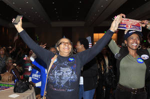 Photo -   Anita Flanigan, left, and Renee Drake celebrate as President Obama reaches the 270 Electoral College votes during the Michigan Democratic election night party at the MGM Grand Detroit, following Election Day, early Wednesday, Nov. 7, 2012. (AP Photo/Carlos Osorio)