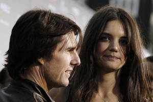 "Photo -   FILE - In this Monday, March 28, 2011 file photo, cast member Katie Holmes, right, and Tom Cruise arrive at the premiere of ""The Kennedys"" at The Academy of Motion Pictures Arts and Sciences in Beverly Hills, Calif. Cruise and Homes are calling it quits after five years of marriage. Holmes' attorney Jonathan Wolfe said Friday June 29, 2012 that the couple is divorcing, but called it a private matter for the family. (AP Photo/Matt Sayles)"