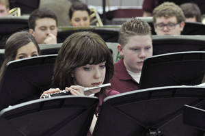 Photo -      Nina Palmer plays flute in the Edmond Memorial High School wind ensemble during the Swine Week concert at the school. Photo by M. Tim Blake, for The Oklahoman  <strong>M. Tim Blake</strong>