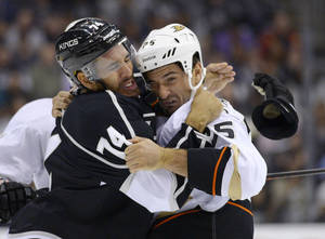 Photo - Los Angeles Kings center Dwight King, left, and Anaheim Ducks right wing Brad Staubitz fight during the first period of an NHL preseason hockey game, Tuesday, Sept. 24, 2013, in Los Angeles. (AP Photo/Mark J. Terrill)