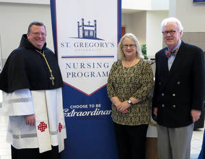 Photo - Abbot Lawrence Stasyszen, left, St. Gregory's University chancellor, poses for a picture with university President D. Gregory Main and the school's director of nursing, Susan Barnes. Photo provided <strong></strong>