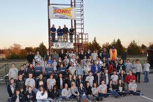 Photo - The Edmond North High School Band is pictured in front of the new Sonic Director's Tower with band director Robert Hullet, Sonic representatives Dane Martin and Brandon Taylor, and Bill Towler, North Band Booster representative.