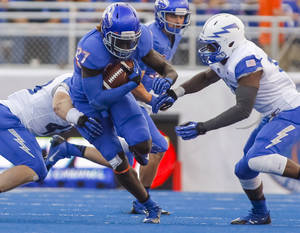 Photo - Boise State running back Jay Ajayi (27) carries the ball during the first half of an NCAA college football game against Air Force in Boise, Idaho, Friday, Sept. 13, 2013. (AP Photo/Otto Kitsinger)