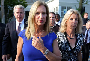 Photo - FILE- In this July 17, 2012 file photo, Kerry Kennedy, ex-wife of New York Gov. Andrew Cuomo, center, is flanked by her brother Christopher Kennedy, left, and sister Rory Kennedy as she walks from the North Castle Justice Court in Armonk, N.Y.  Jurors will hear Monday, Feb. 24, 2014, about Kerry's morning routine and daily medications as they consider whether she's guilty of drugged driving.  The case against Kennedy, daughter of the late Sen. Robert Kennedy, goes to trial Monday morning in suburban White Plains. In 2012, Kennedy was arrested after her car hit a tractor-trailer on an interstate highway near her home in the New York City suburbs. (AP Photo/Craig Ruttle, File)
