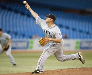 Photo -   Seattle Mariners starting pitcher Kevin Millwood delivers to the Toronto Blue Jays during first-inning baseball game action in Toronto, Wednesday, Sept. 12, 2012. (AP Photo/The Canadian Press, Frank Gunn)