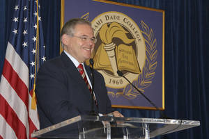"Photo - In this Jan. 31, 2010, image released by Miami Dade College, shows Sen. Robert Menendez, D-N.J., speaks at the signing of his book ""Growing American Roots"" at the college in Miami. Menendez sponsored legislation with incentives for natural gas vehicles conversions that would benefit the biggest political donor to his re-election, Dr. Salomon Melgen, the same eye doctor whose private jet Menendez used for two personal trips to the Dominican Republic, an Associated Press investigation found. (AP Photo/Miami Dade College, Phil Roche)"