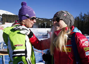 Photo - Germany's Maria Hoefl-Riesch, left, is congratulated by Lindsey Vonn, of the USA, following the women's World Cup downhill ski race in Lake Louise, Alberta, Saturday, Dec. 7, 2013. (AP Photo/The Canadian Press, Jeff McIntosh)