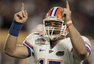 Photo - Florida's  Tim  Tebow signals a touchdown after David Nelson scored in the fourth quarter of the BCS Championship NCAA college football game against Oklahoma in Miami, Thursday, Jan. 8, 2009. (AP Photo/Lynne Sladky)
