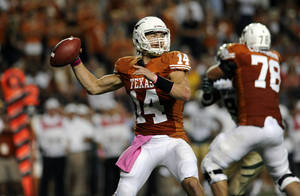 Photo -   Texas quarterback David Ash attempts a throw during the first quarter of an NCAA college football game against Baylor, Saturday, Oct. 20, 2012, in Austin, Texas. (AP Photo,The Daily Texan, Elisabeth Dillon)