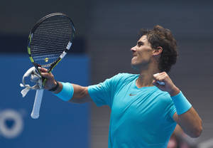 Photo - Rafael Nadal of Spain celebrates after defeating Fabio Fognini of Italy during the quarterfinal match in China Open tennis tournament at the National Tennis Stadium in Beijing, China Friday, Oct. 4, 2013. (AP Photo/Andy Wong)
