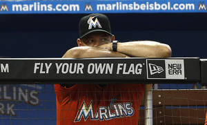 Photo - Miami Marlins pitching coach Chuck Hernandez watches the action against the Colorado Rockies during the sixth inning of a baseball game in Miami, Sunday, Aug. 25, 2013. (AP Photo/J Pat Carter)