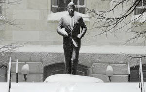 Photo - The statue of President Kennedy is covered with snow outside the Statehouse on Beacon Hill in Boston, Saturday, Feb. 9, 2013. The Boston area received about two feet of snow from a winter storm. A howling storm across the Northeast left the New York-to-Boston corridor shrouded in 1 to 3 feet of snow Saturday, stranding motorists on highways overnight and piling up drifts so high that some homeowners couldn't get their doors open. More than 650,000 homes and businesses were left without electricity. (AP Photo/Charles Krupa)