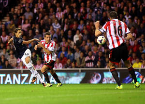 Photo - Manchester United's Adnan Januzaj, left, scores his goal past Sunderland's captain John O'Shea, right, during their English Premier League soccer match at the Stadium of Light, Sunderland, England, Saturday, Oct. 5, 2013. (AP Photo/Scott Heppell)