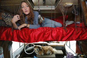 Photo - FILE - This June 4, 2008 photo shows Darlene Knoll, 53, resting in the sleeping area of the battered 1978 motor home where she lives in Los Angeles. A federal appeals court on Thursday, June 19, 2014, struck down a 31-year-old Los Angeles law that bars people from living in parked vehicles, saying the vaguely written statute discriminates against homeless and poor people. (AP Photo/Damian Dovarganes, file)