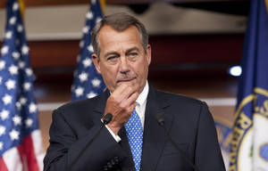 Photo - House Speaker John Boehner of Ohio, meets with the news media at the U.S. Capitol,  in Washington, Thursday, May 9, 2013. (AP Photo/Cliff Owen)