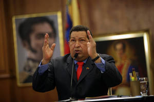 photo -   Venezuela's President Hugo Chavez talks during a press conference at the Miraflores palace in Caracas, Venezuela, Tuesday, Oct. 9, 2012. The 58-year-old former military officer Chavez won his fourth consecutive presidential bid Sunday and shows no signs of ballot fatigue. (AP Photo/Rodrigo Abd)