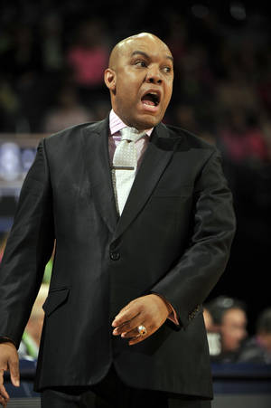 Photo - Syracuse coach Quentin Hillsman reacts to a call during first half action in an NCAA women's basketball game against Notre Dame, Sunday, Feb. 9, 2014, in South Bend, Ind. (AP Photo/Joe Raymond)