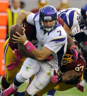 Photo -   Washington Redskins defensive end Stephen Bowen (72) and linebacker Lorenzo Alexander (97) combine to sack Minnesota Vikings quarterback Christian Ponder (7) during the first half of an NFL football game, Sunday, Oct. 14, 2012, in Landover, Md. (AP Photo/Richard Lipski)