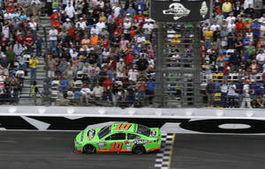 Photo - Danica Patrick cross the start/finish line to take the lead shortly before the halfway point of the Daytona 500 NASCAR Sprint Cup Series auto race Sunday, Feb. 24, 2013, at Daytona International Speedway in Daytona Beach, Fla. (AP Photo/Chris O'Meara)