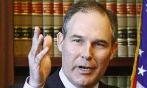 Photo - Oklahoma Republican Attorney General-elect Scott Pruitt gestures as he speaks at a news conference in Oklahoma City, Friday, Jan. 7, 2011. Pruitt said he plans to file a lawsuit soon after he's sworn into office on Monday to challenge the federal government over the new federal health care law..(AP Photo/Sue Ogrocki)