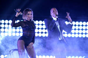"Photo - Beyonce, left, and Jay-Z perform ""Drunk in Love"" at the 56th annual Grammy Awards at Staples Center on Sunday, Jan. 26, 2014, in Los Angeles. (Photo by Matt Sayles/Invision/AP)"