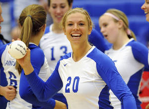 Photo - FILE - This 2010 file photo provided by Saint Louis University Athletics shows former volleyball player Megan Boken before a match in St. Louis. A court hearing is scheduled for Friday, Nov. 22, 2013 in St. Louis, for Keith Esters, accused of killing Boken — who was also a Saint Louis University athlete — in a robbery to take her smartphone.(AP Photo/Saint Louis University Athletics, File)