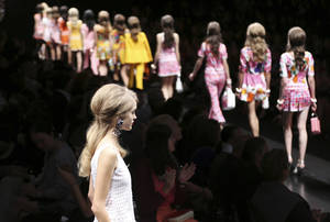 Photo -   Models wear creations part of the Moschino women's Spring-Summer 2013 fashion collection, during the fashion week in Milan, Italy, Friday, Sept. 21, 2012. (AP Photo/Antonio Calanni)