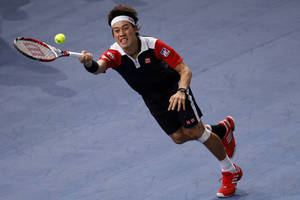 Photo - Japan's Kei Nishikori returns the ball to France's Jo-Wilfried Tsonga, during their second round match, at the Paris Masters tennis at Bercy Arena in Paris, France, Tuesday, Oct. 29, 2013. (AP Photo/Francois Mori)