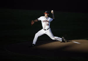 Photo - Virginia pitcher Nathan Kirby (19) throws a pitch in the first inning of one of the best-of-three games against Vanderbilt in the NCAA baseball College World Series finals in Omaha, Neb., Monday, June 23, 2014. (AP Photo/Nati Harnik)