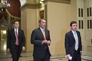 "photo - Speaker of the House John Boehner, R-Ohio, walks to the House floor during a vote at the Capitol in Washington, Wednesday evening, Dec. 12, 2012. Boehner and the other House Republican leaders are calling for Obama to come up with plan they can accept for spending cuts and tax revenue to avoid the so-called ""fiscal cliff"" of automatic tax hikes and budget reductions. (AP Photo/J. Scott Applewhite)"