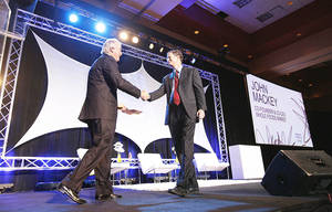 photo - Aubrey McClendon, CEO of Chesapeake Energy, (left), and John Mackey, Co-CEO and Co-Founder of Whole Foods Market, share the stage during the Creative Oklahoma Conference in November in Norman.  Photo by Steve Sisney, The Oklahoman