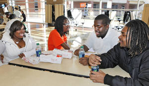 Photo - Seniors Shayna Bruner, Deshun Fisher, Christine Gray and Angelo Jones eat an after-school snack before they start night school classes at Douglass High School. More than 30 students are enrolled in evening courses this semester. <strong>David McDaniel - THE OKLAHOMAN</strong>