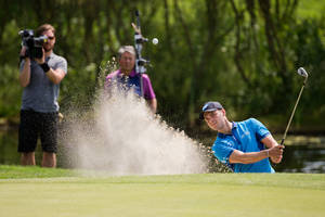 Photo - German  US open winner  Martin Kaymer  plays a ball out of the bunker during the BMW  International Open golf tournament at Gut Laerchenhof in Pulheim near Cologne, Germany,  Thursday June 26, 2014. (AP Photo/dpa,Rolf Vennenbernd)