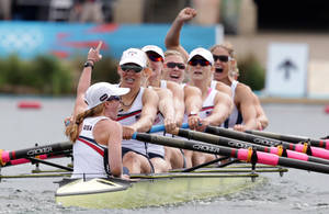 Photo -   U.S. rowers Mary Whipple, Caryn Davies, Caroline Lind, Eleanor Logan, Meghan Musnicki, Taylor Ritzel, Esther Lofgren, Zsuzsanna Francia, and Erin Cafaro celebrate after winning the gold medal for the women's rowing eight in Eton Dorney, near Windsor, England, at the 2012 Summer Olympics, Thursday, Aug. 2, 2012. (AP Photo/Armando Franca,Pool)