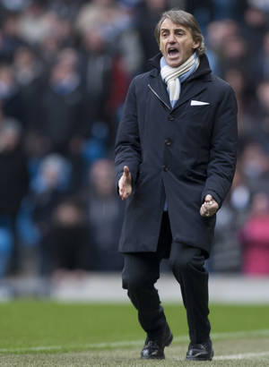 photo - Manchester City's manager Roberto Mancini issues instructions during his team's English Premier League soccer match against Chelse at The Etihad Stadium, Manchester, England, Sunday Feb. 24, 2013. (AP Photo/Jon Super)