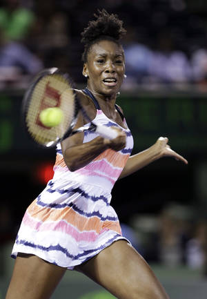 Photo - Venus Williams returns a shot from Kimiko Date-Krumm, of Japan, during the Sony Open tennis tournament, Thursday, March 21, 2013 in Key Biscayne, Fla. Williams won 7-6 (3) 3-6, 6-4. (AP Photo/Wilfredo Lee)