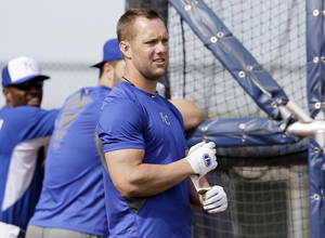 Photo - Kansas City Royals' Alex Gordon prepares for a batting session during spring training baseball practice, Wednesday, Feb. 19, 2014, in Surprise, Ariz. (AP Photo/Tony Gutierrez)