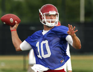 Photo - COLLEGE FOOTBALL: Quarterback Blake Bell (10) throws during the University of Oklahoma (OU) Sooners first day of practice on Thursday, August 4, 2011, in Norman, Okla.   Photo by Steve Sisney, The Oklahoman ORG XMIT: KOD