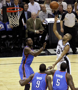 photo - San Antonio's Tony Parker (9) puts up a shot over Oklahoma City's Kevin Durant (35) during Game 2 of the Western Conference Finals between the Oklahoma City Thunder and the San Antonio Spurs in the NBA playoffs at the AT&T Center in San Antonio, Texas, Tuesday, May 29, 2012. Oklahoma City lost 120-111. Photo by Bryan Terry, The Oklahoman