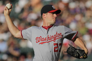 photo -   Washington Nationals starting pitcher Jordan Zimmermann (27) pitches to Colorado Rockies' Dexter Fowler during the first inning of a baseball game on Wednesday, June 27, 2012, in Denver, Colo. (AP Photo/Barry Gutierrez)