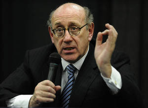 Photo - FILE - In this July 11, 2013 file photo, attorney and special adviser Kenneth Feinberg speaks at a public forum on the distribution of Newtown donations at Edmond Town Hall in Newtown, Conn. Feinberg plans to announce the terms of General Motors' plan to pay victims of crashes caused by bad ignition switches on Monday, June 30, 2014. (AP Photo/Jessica Hill, File)