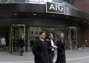 photo - People pass the AIG building, in New York, Tuesday, Jan. 8, 2013. American International Group Inc. said Tuesday its board of directors will weigh whether to take part in a shareholder lawsuit against the U.S. over the government's $182 billion bailout of the insurer. (AP Photo/Richard Drew)