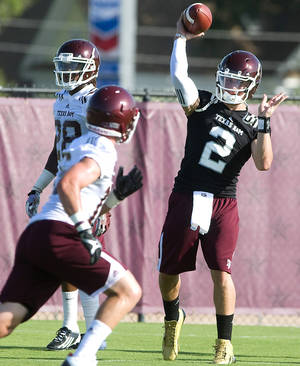 photo - FILE - In this Aug. 3, 2012, file photo, Texas A&M quarterback Johnny Manziel (2) throws passes on the first day of the team's NCAA college fall football practice in College Station, Texas. Former Houston coach Kevin Sumlin said Manziel will start Texas A&M's opener against Louisiana Tech on Aug. 30 as the Aggies prepare for their first season in the Southeastern Conference. (AP Photo/Bryan College Station Eagle, Stuart Villanueva, File) ORG XMIT: TXBRY301
