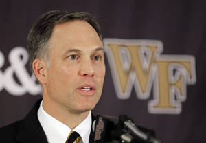 Photo - Newly-named Wake Forest head football coach Dave Clawson speaks to  the media during an NCAA college football news conference in Winston-Salem, N.C., Tuesday, Dec. 10, 2013. (AP Photo/Chuck Burton)