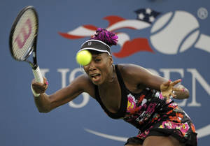 Photo - Venus Williams returns a shot to Jie Zheng, of China, during the 2013 U.S. Open tennis tournament, Wednesday, Aug. 28, 2013, in New York. (AP Photo/Kathy Kmonicek)