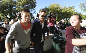 "Photo - Hollywood actor Chris Pine, center, arrives at a courthouse in Ashburton, New Zealand, Monday, March 17, 2014.  Pine, known for playing Captain Kirk in the ""Star Trek"" movies, pleaded guilty in the New Zealand court to drunken-driving charges.  The 33-year-old was fined $93 New Zealand dollars ($79) and had his New Zealand driver's license suspended for six months during a hearing at the Ashburton District Court. (AP Photo/Ashburton Guardian, Tetsuro Mitomo) NEW ZEALAND OUT, AUSTRALIA OUT, NO SALES"